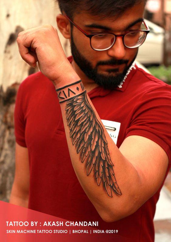 049e5dd43a4e7237c9141487cb79a710 25 Diseños de Tatuajes de Alas en los Brazos